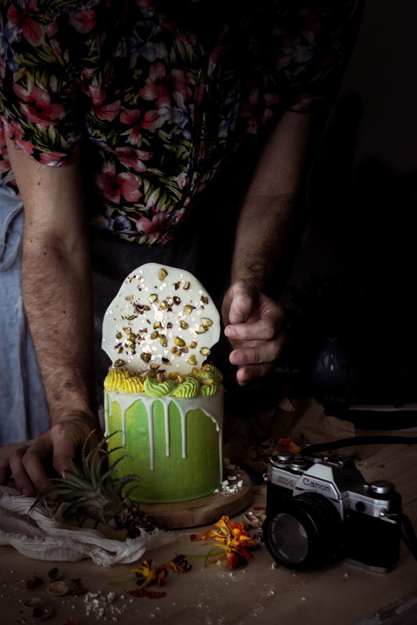 green pistachio cake and white chocolate drip